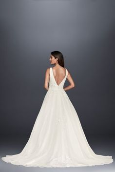 A dream of a wedding dress! This V-neck ball gown is topped with beaded lace  appliques on the mikado bodice and tulle skirt e9dc730356ab