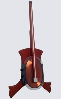 The Magnetic Cello is a stringless instrument by California-based company Magnetovore that's shaped like a cello and utilizes a resistive ribbon, copper coil, and a magnetic bow to create a deep el...