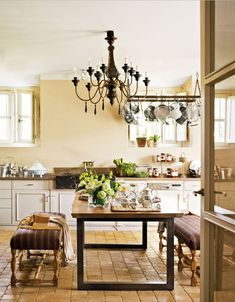 restored farmhouse kitchen in spain (view 2)  Love the hanging pots