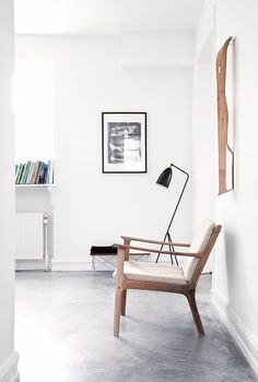 Grasshopper Lamp, mid century chair and a few art pieces on the walls. Are you looking for unique and beautiful art photo prints to curate your art wall... Visit bx3foto.etsy.com