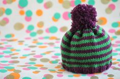 12 free knitting patterns for beginners: striped baby hat on LoveKnitting
