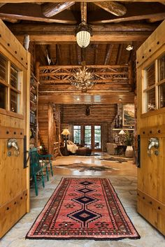 Fabulous log home with western furnishings.  Check out the horse head door features