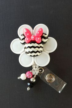Check out this item in my Etsy shop https://www.etsy.com/listing/275765606/minne-mouse-vial-cap-retractable-badge