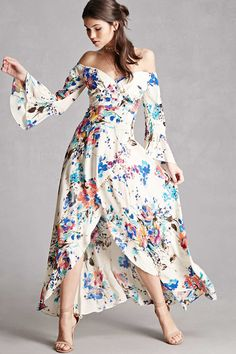 A woven maxi dress by Selfie Leslie™ featuring an off-the-shoulder sweetheart neckline, long trumpet sleeves, padded cups, a wrap front, an allover floral print, concealed zipper back, and an asymmetrical hem.