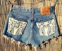Cut off jean shorts with lace pockets.