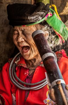 Faces of Vietnam | Smoking class with Hmong | Old woman near Dong Van in North of Vietnam. I asked her to show me how to smoke the Thuoc Lao (Long vietnamese pipe). She is 73 years old! | by Réhahn