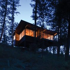 This gorgeous and cozy cabin retreat on Flathead Lake is located in Polson, Montana and designed by Andersson Wise Architects. Flathead Lake Montana, Cabana, Butterfly Roof, House On Stilts, Cabin In The Woods, Wooden Cabins, Lake Cabins, Seen, Beach Cottages