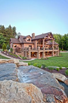 Lake house log cabin with a stream