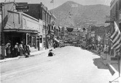 A view of a Fourth of July Coaster Race participant going down Main Street in Bisbee, Arizona.  This image is from the photograph collection of the Bisbee Mining & Historical Museum.  Discover more Bisbee, Arizona images and artifacts at www.facebook.com/BisbeeMuseum.GangNam16