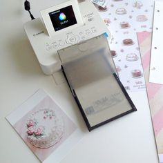 The adorable Selphy mini printer. Perfect for Scrapbooking, art journaling, card making etc.