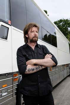 "Ronnie Dunn's Tour Bus, Ronnie Dunn poses for a photo in front of his tour bus during the filming of HGTV's Celebrity Motor Homes. Dunn affectionately refers to his tour bus as ""Pearle"" because of its white color.  Photo by Donn Jones Photography. © 2012, HGTV/Scripps Networks, LLC.  All Rights Reserved.  Ronnie's Official GACTV.com Photo Gallery >>  For more on HGTV's. The better half of Brooks & Dunn."