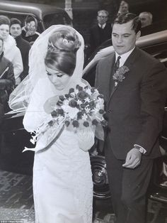 Frances Shea with her brother Frankie Shea who used to be Reggie Krays Driver arriving for her wedding on the 20th April 1965.