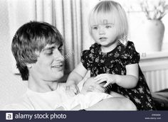 Mike Oldfield, musician and composer, pictured at home with family, eldest daughter Molly and baby son Dougal, Buckinghamshire, September 1981. Stock Photo Mike Oldfield, Dark Star, Sons, Parents, Daughter, Stock Photos, Children, Baby, September