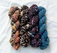Clearing out leftover singles from bobbins in preparation for Spinzilla! Look at these cute little handspun skeinlets!