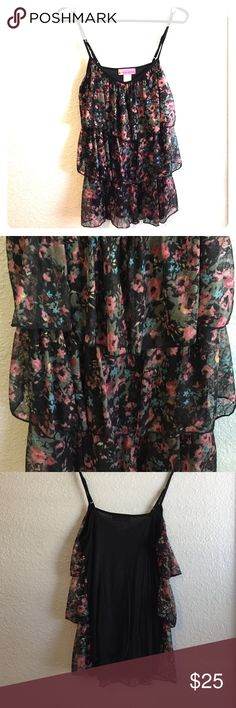 3 tier floral tank NWOT. So cute and flowy! Would be super easy to dress up or down. Three ruffles on front, solid black knit back. Adjustable shoulder straps. 92% polyester 8% spandex Body Central Tops Tank Tops
