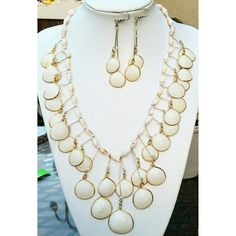 Hippie Boho White Shell Gold Tone Bib Necklace Set Beautiful Necklace and Earrings set in excellent condition. Such a stunning set. Each shell is placed in a gold tone trim setting. Great statement piece for summer! Jewelry Necklaces