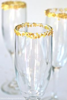 Edible star glitter on the rim of champagne glasses for New Year's Eve