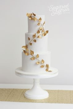 Wrapped Gold Leaves wedding cake by the Sugared Saffron Cake Studio in London