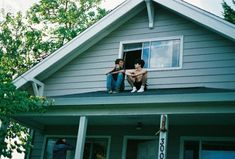 They love to sit on roofs with each other