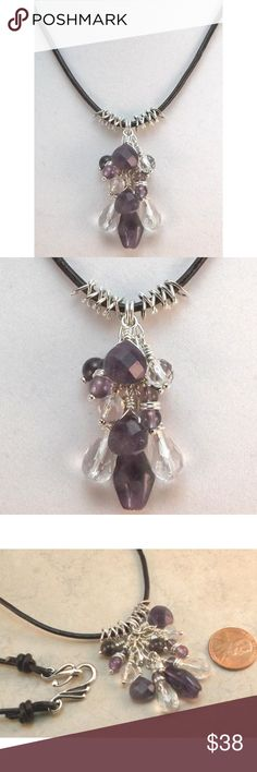 """Amethyst Crystal & Silver Cluster Pendant Necklace This One-Of-A-Kind cluster pendant leather necklace features beautiful faceted and smooth Amethyst and natural Crystal beads in a variety of shapes and sizes. Hand-crafted in the USA.  The 2mm black leather necklace is approximately 26 1/2"""" long. It's long enough to slip over your head and has slip knots on either side of the clasp so you can easily adjust the length.  Findings and metal embellishments are silver plated copper. Twisted…"""