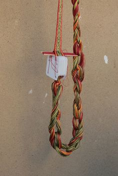 This looks amazing, investigate >>chained tablet-weaving warp - a good way to keep the tail from tangling!