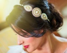 I want to make this headband! It's so pretty. I reckon I could make it by using some embroidery and beading techniques.
