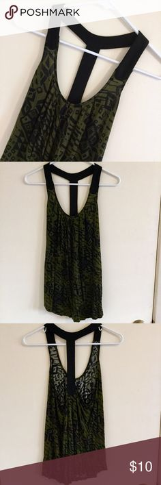 Urban Outfitters Green and Black Halter Top -Flowy top with a bold pattern -Has a t-strap halter style back -The plastic bands used for hanging the shirt have been cut off. Please ref to 4th photo. -Perfect with shorts in the spring/summer or layered under a cardigan in the fall/winter! -Ask me if you have any questions! Urban Outfitters Tops Tank Tops