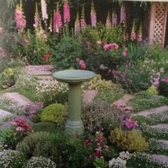 I want my shade garden to resemble this! hummmm........ Hostas and gladiolas?