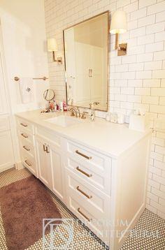 Caesarstone vanity, penny round tile floor, subway wall!!!!!....brass hardware