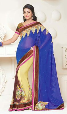 Blue, cream and saddle brown chiffon georgette sari is a tri color sari with floral and paisley inspired motifs. The sari is garnished with golden lace, silk thread embroidered border and motifs and scattered crystal stones which makes you too look quite stylish and fashionable. Sari pairs with contrast brown jacquard stitched blouse as shown in the picture. #LatestEveningWearSarees