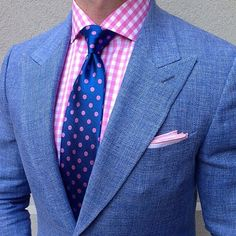 Pink gingham shirt, blue tie with pink dots. That settles it, I'm getting a gingham shirt