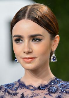 By now you've probably seen all the best hair and makeup looks from the Oscars 2013 red carpet (and click here if you haven't!), so now it's time to talk about the heads that didn't walk the red carpet—the best updos I spotted in the film from all the after-parties. First up we have Lily Collins. I'll all about this cool tucked-under, and fanned out low style: Natalie Portman went with a sleek French twist: Emmy Rossum opted for a braided bun with a dressy headband: And Zo...