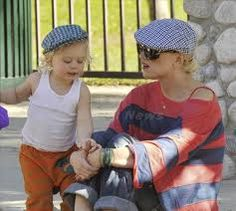 Gwen and Zuma wearing almost matching flat caps.  Henry Hats of Hawaii will launch their parent / child matching flat caps in Spring 13. Even Zumas hat looks too small, a Henry Hats of Hawaii flat caps grow with each child from newborn to tween-ager