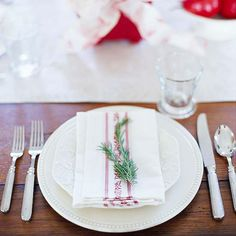 Sometimes Mother Nature knows best, as in this simple table setting that features a napkin accented by a single pine sprig. http://www.bhg.com/christmas/indoor-decorating/festive-holiday-napkin-ideas/?socsrc=bhgpin122014evergreennapkinembellishment&page=27