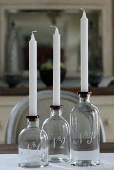Numbered apothecary jar candle holders... It think you could make these by hand and save a lot!