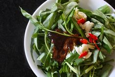 Pak Bung* Fai Daeng (ผักบุ้งไฟแดง ) is one of a few Thai street foods that can be made at home very easily, quickly, and with great results. The ingredient list is short; so is the preparation time…