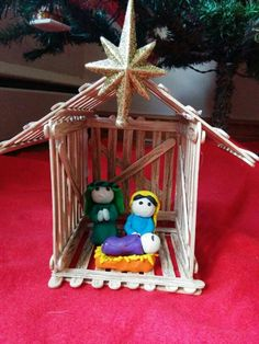 Nativity Scene with popsicle stick manger and clay figurines made with Taylor n Luis