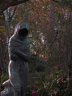"""A cloaked figure clutches herself in the fast pass nook next the Haunted Mansion at Disneyland, CA. I think not a lot of people know about this hidden nook. It was really interesting. So secluded and a slight eerie feeling to it."""