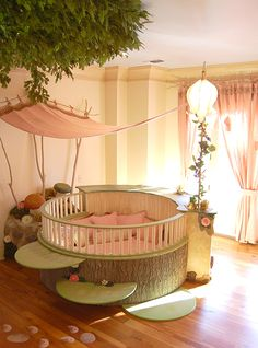Girl's Fairy Nursery. lluminated by two beautiful flower-shaped lamps, the six-foot-diameter circular bed becomes the centerpiece of the room. Imitation bark on the bed's exterior augments the room's theme and makes it easy for a child to believe they have stepped out of the suburbs and into the forest. Three lily pads extending from tree bark serve as both steps to the bed and stools to sit on.
