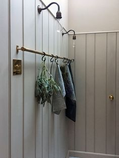 The pantry features a beautiful brass hanging rail