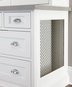 Clever Radiator Disguise -  False drawer fronts hide a radiator; metal mesh on the end cap allows heat to escape.