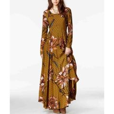 Free people printed maxi dress Self & lining: rayon Machine wash or dry clean Imported Round neck, long sleeves, angled empire waist seam, allover floral and diamond print Deep keyhole back with four-button closure, flared silhouette, lined Free People Dresses Maxi