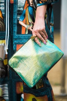 30 Awesome Outfit Ideas Straight Out Of SXSW #refinery29  http://www.refinery29.com/2016/03/106504/sxsw-street-style-photos-2016#slide-3  Holographic handbags > most other handbags....