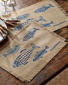 You'll have visions of the open sea when you set the table with this rugged placemat. Made from durable natural burlap, it's defined by our charming fish design. Perfect for a seafood banquet or a shrimp BBQ under the stars on the patio. Fringed edges provide a touch of rustic island charm. Burlap. 13in. x 19in. Imported. 9136.