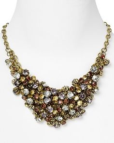 statement necklaces have become a huge part of my wardrobe lately. neutral or mixed metal ones look great with cocktail dresses AND add pizzaz to a casual outfit. i love to add fall colored statement necklaces when wearing black, white or ivory tops.