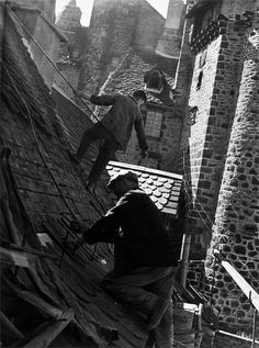 Brassaï, A Salers (Auvergne), 1949 I don't know why, but it reminds me of Mary Poppins, when they dance on the roofs!