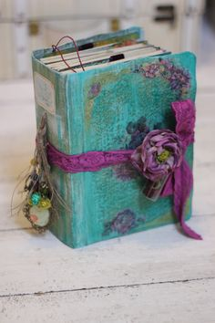 This custom made photo journal is created using a mixture of painted,block printed and handmade paper pages with distressed edges. This item is