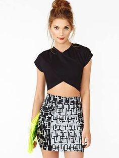 sleek crop top with criss cross seams!