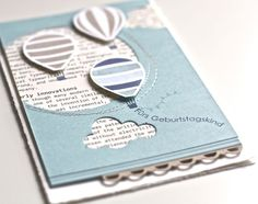 Love the newsprint in the background and the stitching on this balloon card!
