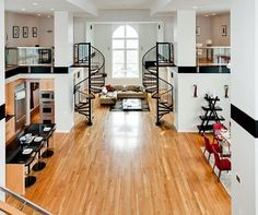 Spacious living room with twin spiral staircases and mezzanines